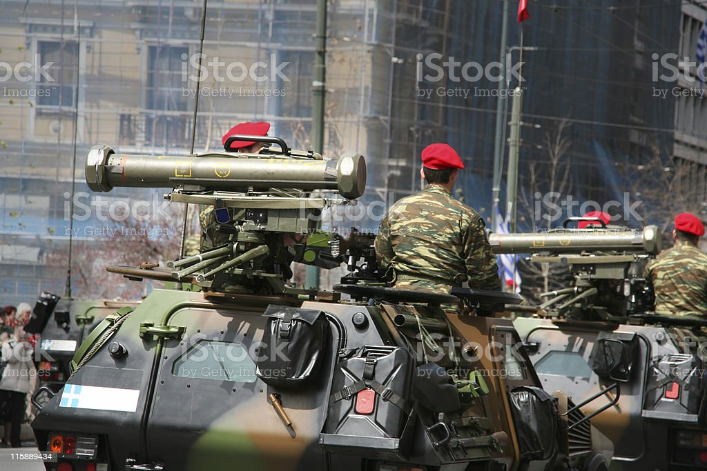 Soldiers in armed vehicle royalty-free stock photo