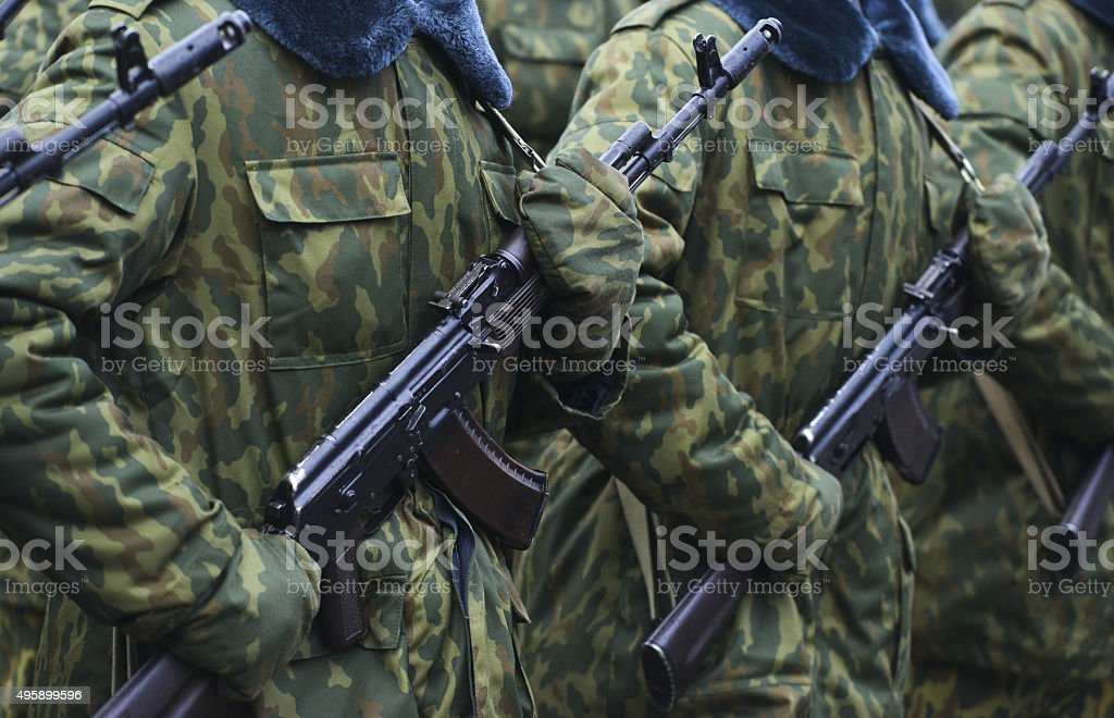 Soldiers in camouflage military uniform on rest position stock photo