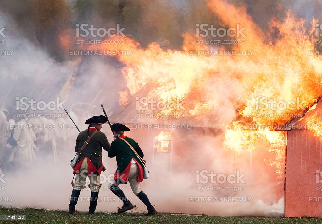 soldiers in front of a fire stock photo