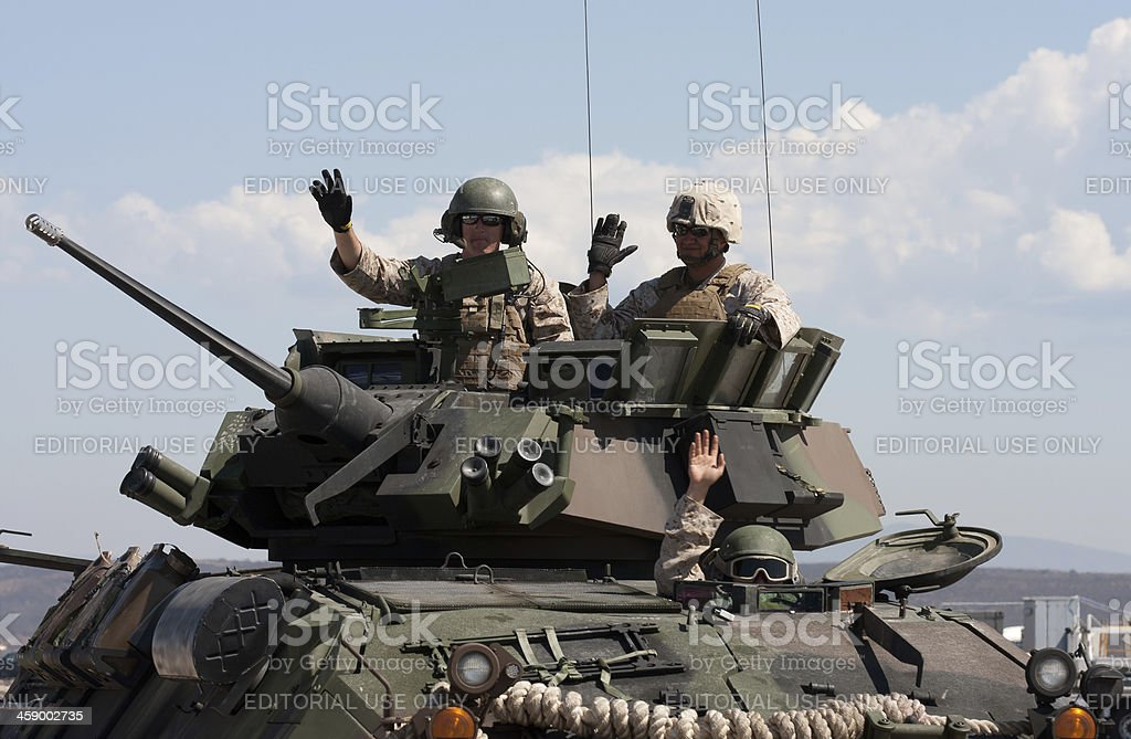 Soldiers In Green Tank stock photo