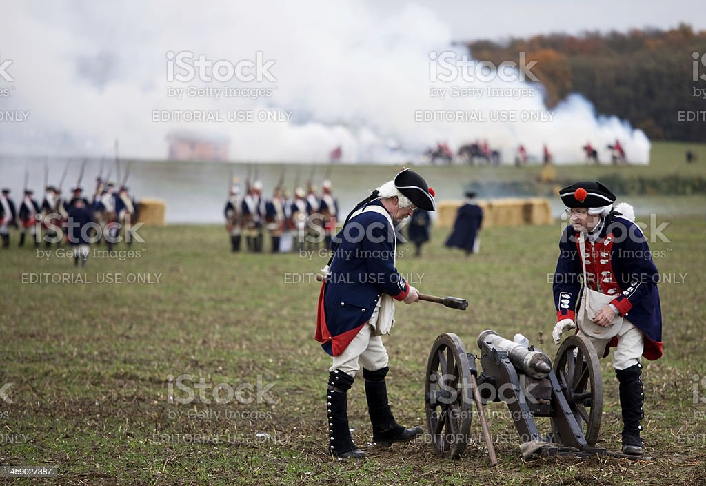 soldiers in historic regimentals firing off cannon stock photo