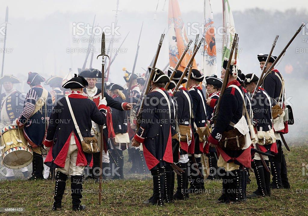 soldiers in historic regimentals on battlefield stock photo