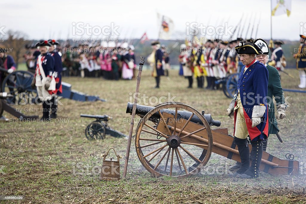 soldiers in historic regimentals with medieval cannon stock photo