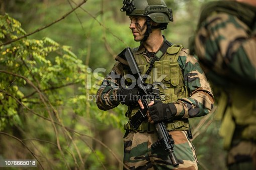 Soldiers in a forest in camouflage clothing ,searching for enemies
