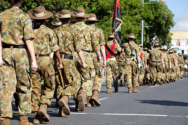 Soldiers Marching Away on Anzac Day stock photo
