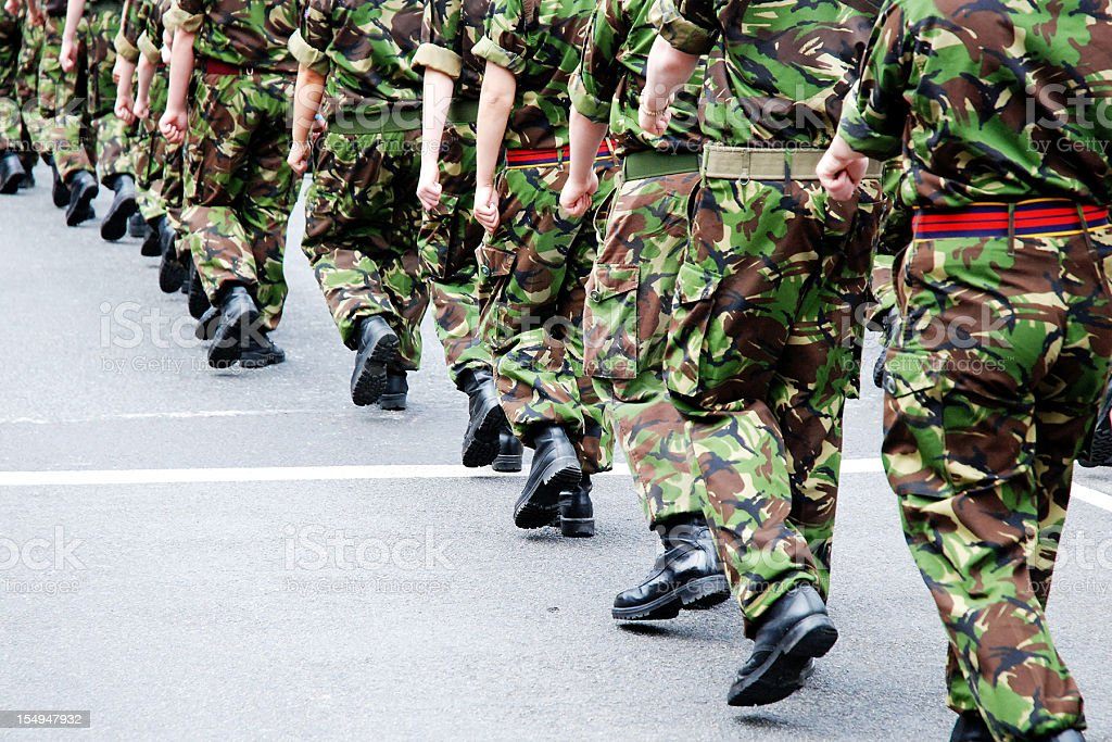 Soldiers marching in line stock photo