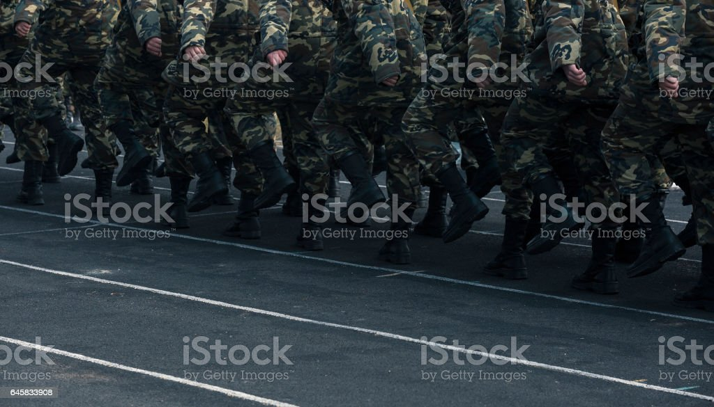 Soldiers marching on ground stock photo