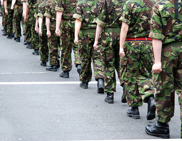 Soldiers marching Soldiers marching military parade stock pictures, royalty-free photos & images