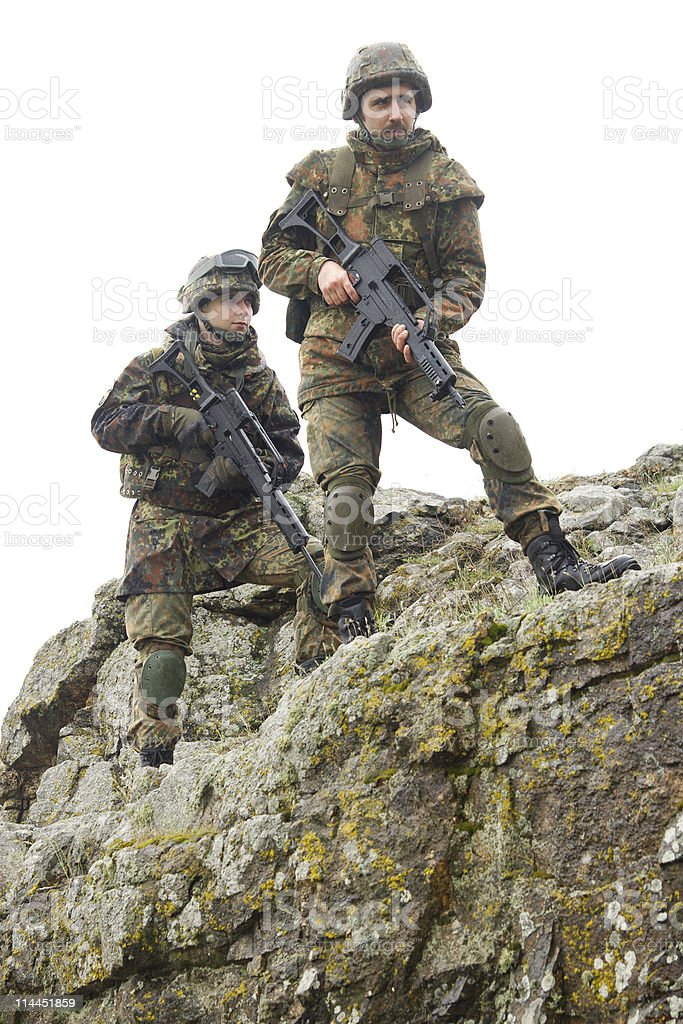 Soldiers moving on mountain with guns royalty-free stock photo