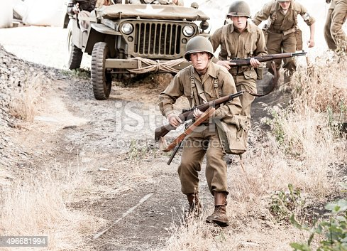 Soldiers on Patrol with Rifles held in a ready position - WWII - Stock Image