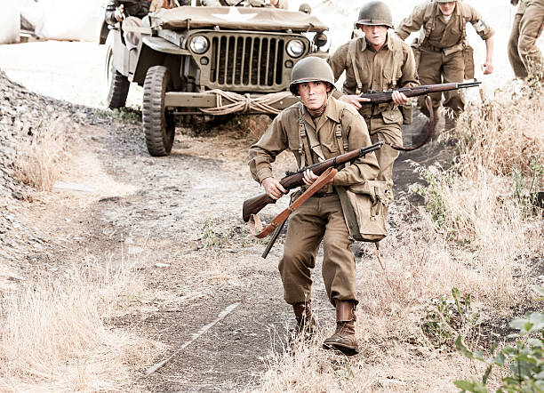soldiers on patrol wwii - world war ii stock photos and pictures