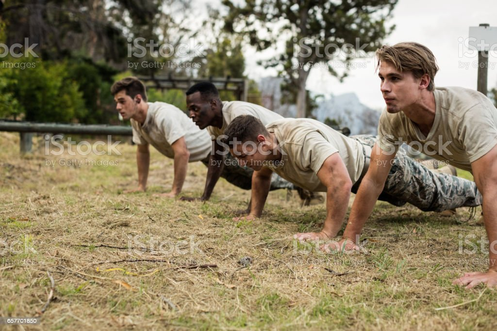 Soldiers performing pushup exercise stock photo