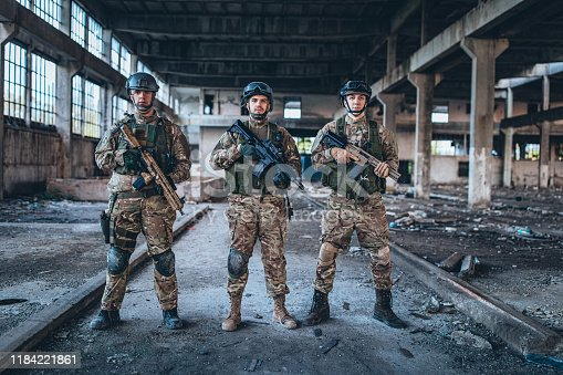 Group of soldiers in war zone