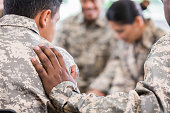 Soldiers pray during therapy session
