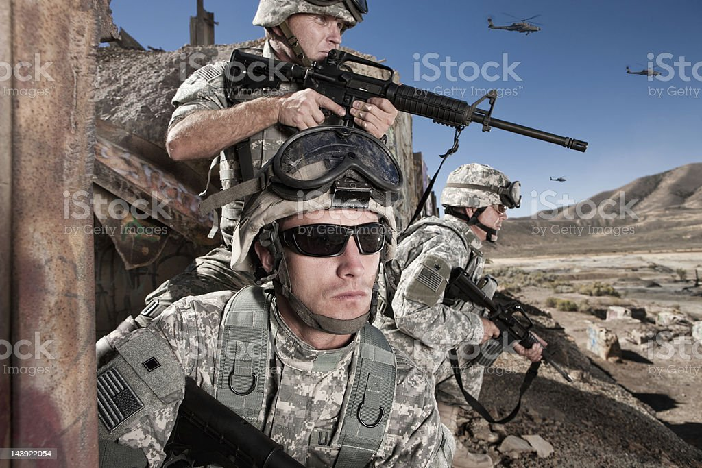 Soldiers Provide Cover in the Desert stock photo