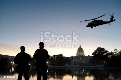 Soldiers guard Capitol Hill as a helicopter patrols the air. Grab the separate elements here: