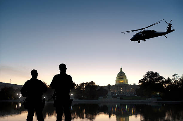 Soldiers Provide Homeland Security at Capitol Hill Soldiers guard Capitol Hill as a helicopter patrols the air. Grab the separate elements here: department of homeland security stock pictures, royalty-free photos & images