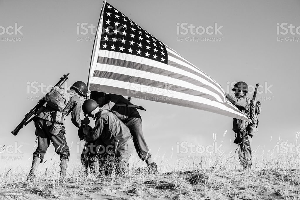 Soldiers Raising the US Flag stock photo