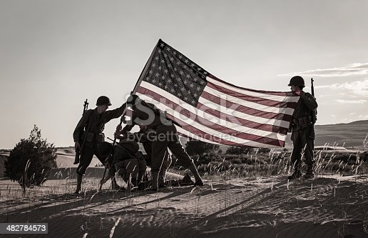 Soldiers Raising the US Flag (Stock Image)
