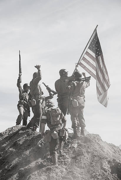 soldiers raising the us flag - world war ii stock photos and pictures
