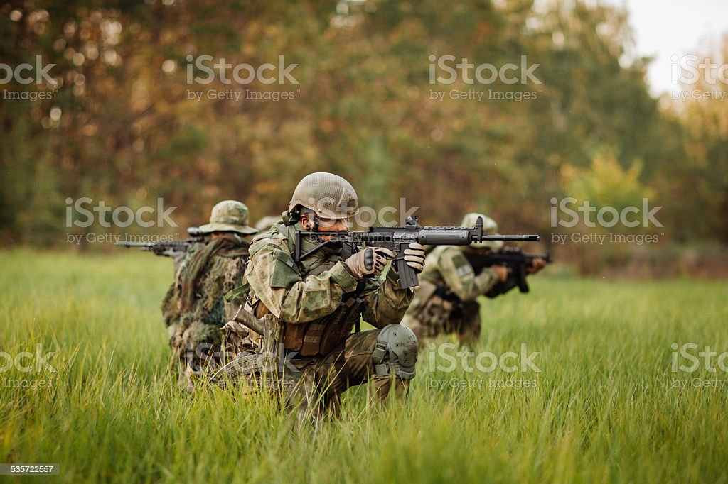 soldiers shoot at the enemy stock photo