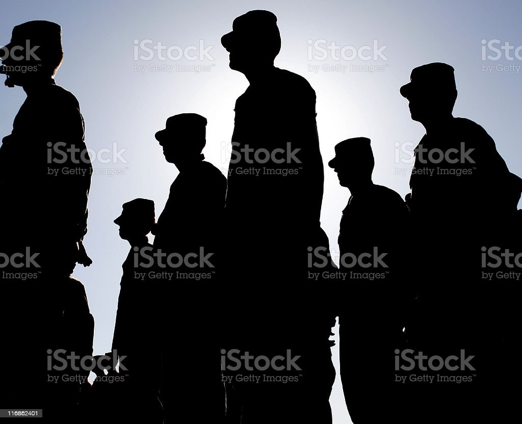 Soldiers Stand at Attention during Sunset royalty-free stock photo