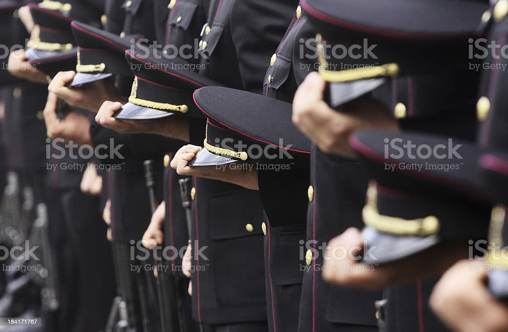 Soldiers standing in line and holding their hats stock photo