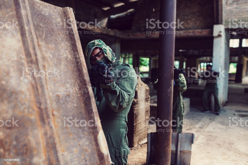 Soldiers taking their positions on battle field stock photo