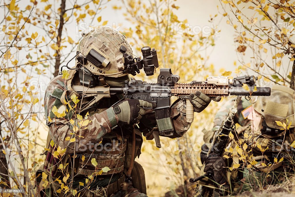 Soldiers team aiming at a target of weapons stock photo