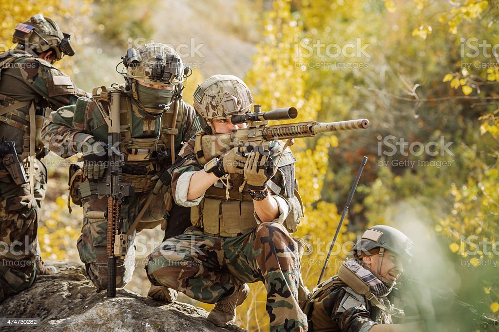 Soldiers team preparing to attack the enemy stock photo