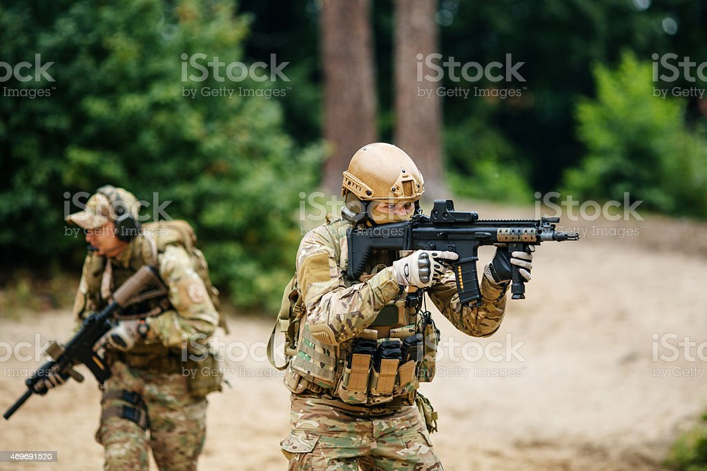 Soldiers team with guns watching territory stock photo