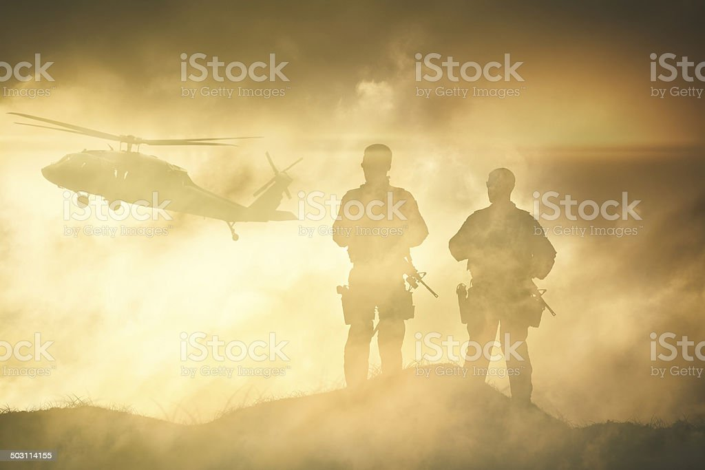 Soldiers wait for a Helicopter in Dust Storm stock photo