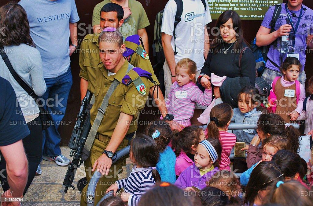 Soldiers with guns at the Wailing Wall, Jerusalem, Israel stock photo