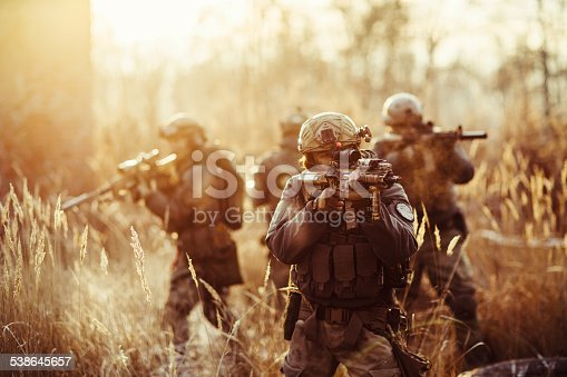 istock soldiers with guns on the field 538645657