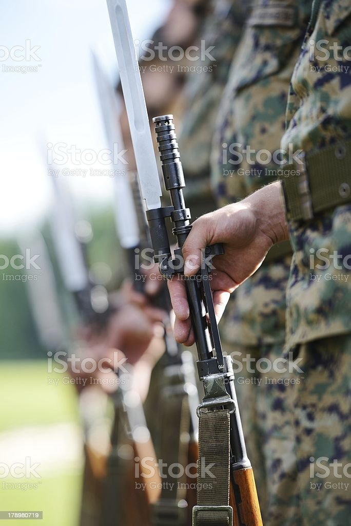 Soldiers with military camouflage uniform in army formation stock photo