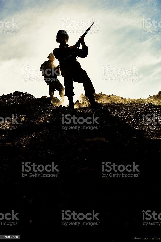 Soldiers with running down hill. stock photo