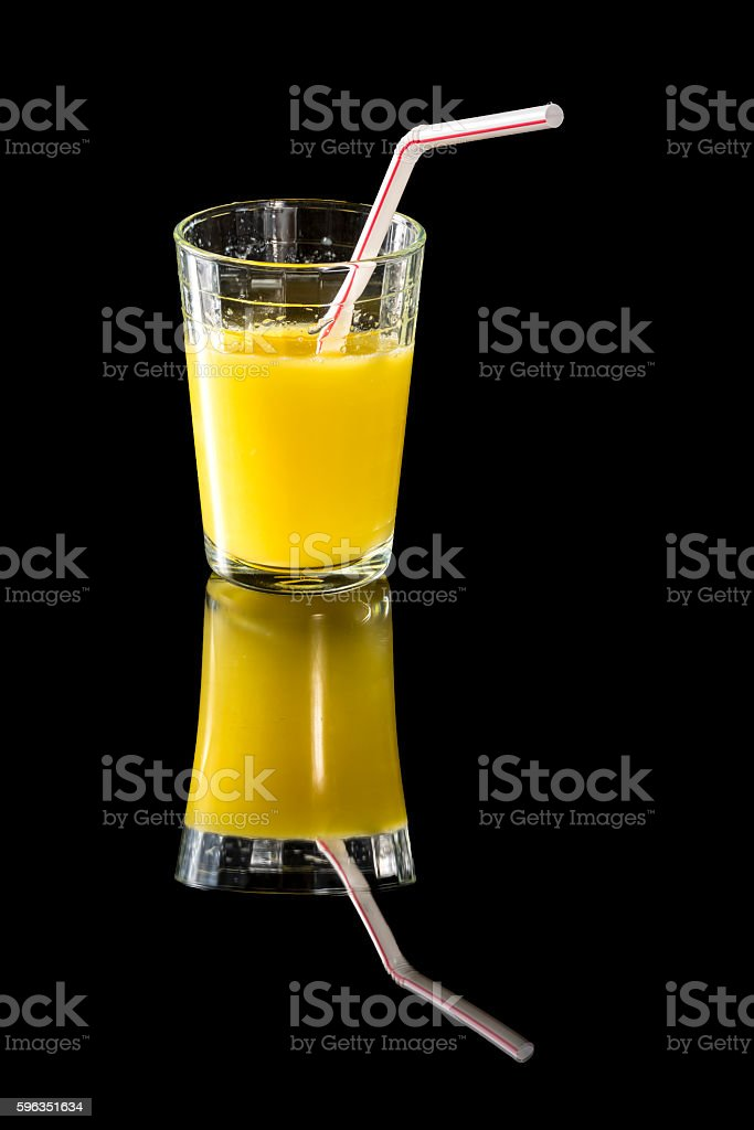 solemn glass of fresh orange juice with a straw royalty-free stock photo