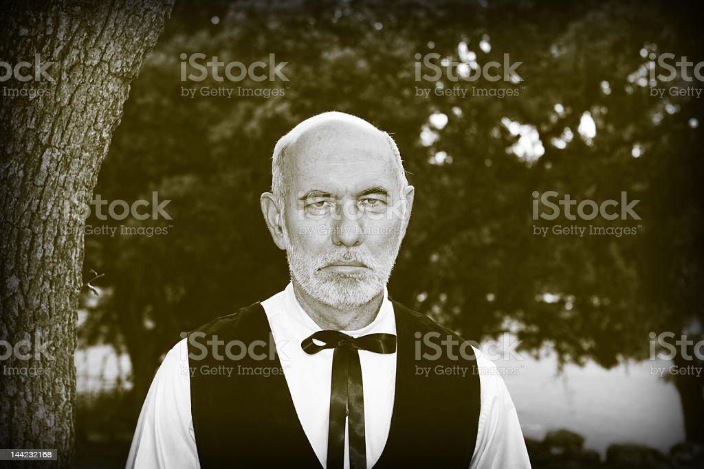 Solemn Old-Fashioned Preacher Parson Outside Black White Sepia royalty-free stock photo