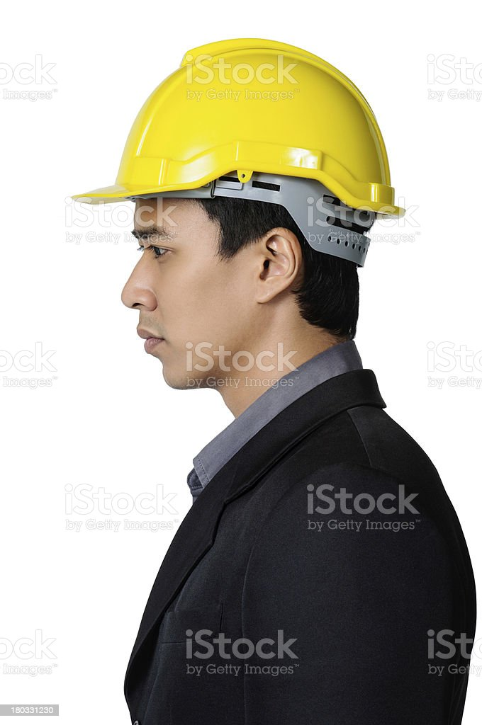 solemn young foreman on the side view isolated royalty-free stock photo
