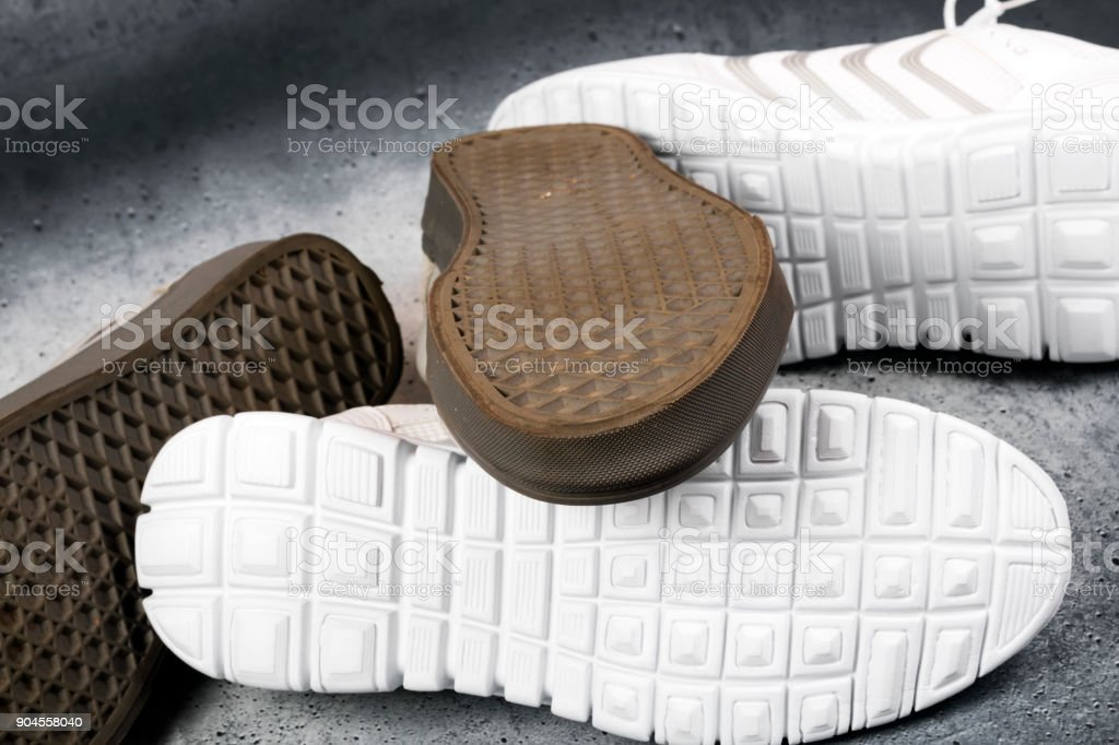 Soles of white and brown sports shoes. stock photo
