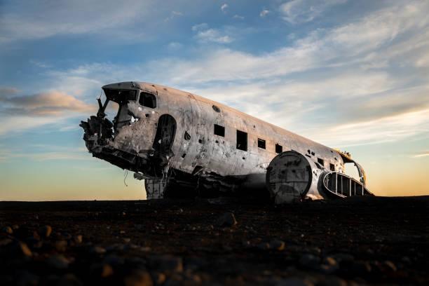 Solheimasandur plane wreck The famous wreckage in sunset. sólheimasandur stock pictures, royalty-free photos & images