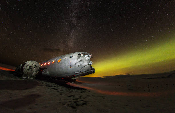 Solheimasandur plane wreck with active norhtern lights, Iceland. Solheimasandur plane wreck with active norhtern lights, Iceland, Europe. sólheimasandur stock pictures, royalty-free photos & images