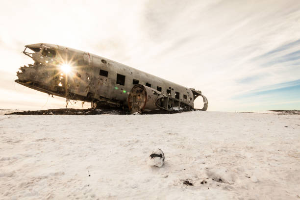 Solheimasandur the plane wreck view during winter snow Solheimasandur the plane wreck view during winter snow sólheimasandur stock pictures, royalty-free photos & images