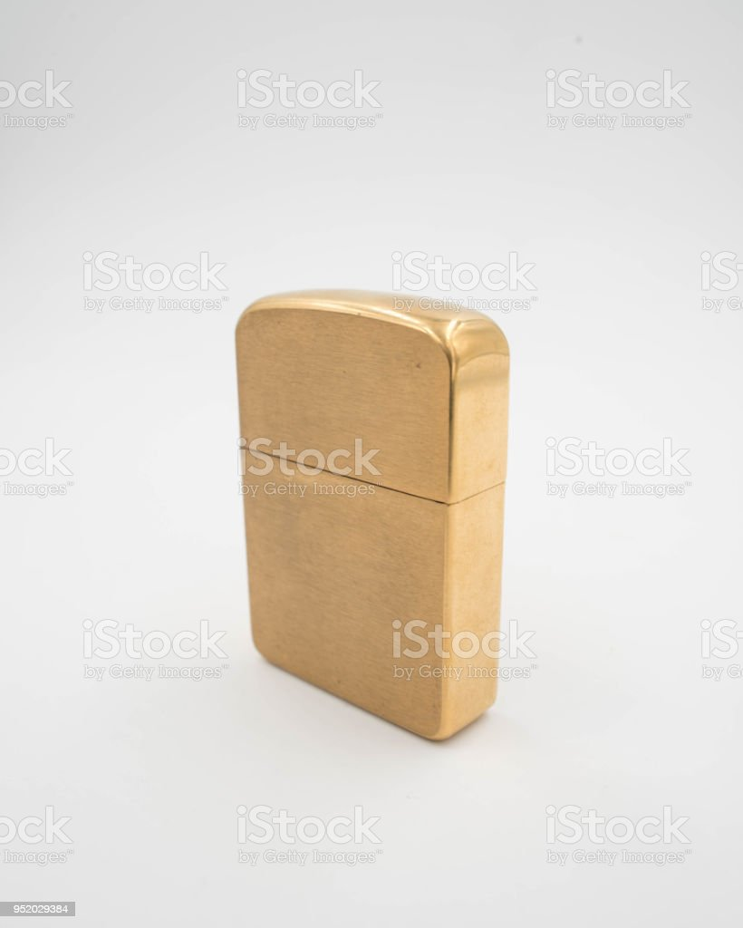 Solid Brass Windproof Lighter isolated on a white background stock photo