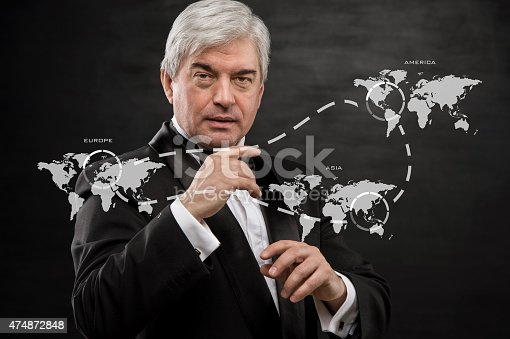 498272366 istock photo Solid business man working with virtual interface 474872848