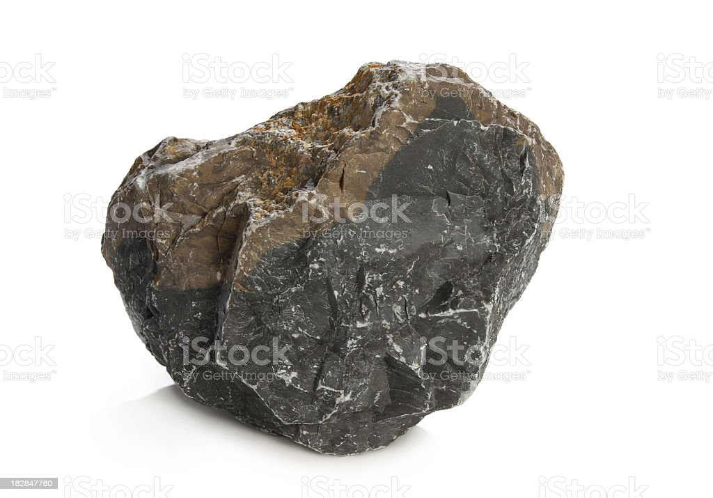 A solid dark rock on a white background stock photo