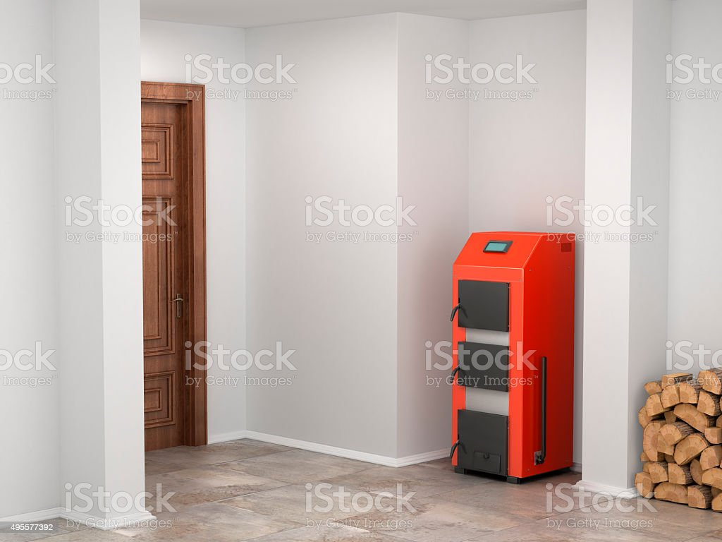 Solid fuel boiler in the basement stock photo