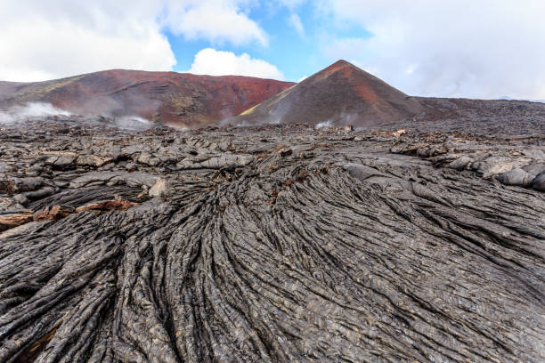 Solid lava plain near active volcano Tolbachik, Kamchatka, Russia Solid lava plain near active volcano Tolbachik, Kamchatka, Russia kamchatka peninsula stock pictures, royalty-free photos & images