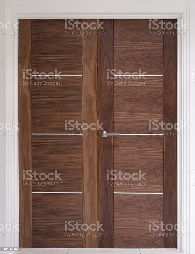 Solid walnut double doors royalty-free stock photo
