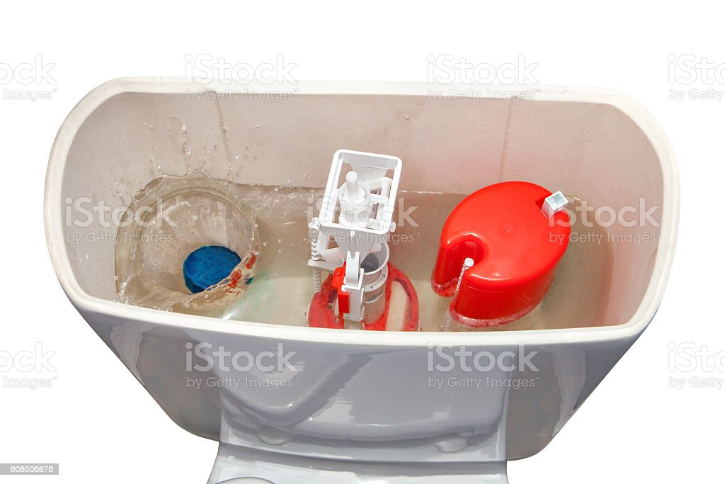 Solid water-soluble cleanser thrown into the water cistern toilet. stock photo